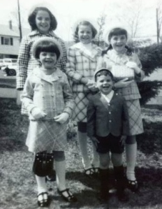 When we were five: that's me, the tallest, in my patriotic Easter outfit circa 1970.  My youngest sister had not yet arrived.