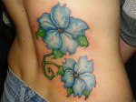 """Blue Flowers,"" one of Kristin Foley's custom tattoos."