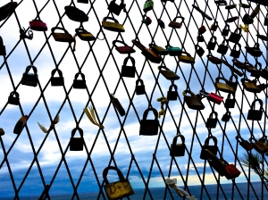 """Love locks"" on a fence erected to prevent suicides high over the Adriatic Sea in Dubrovnik, Croatia."